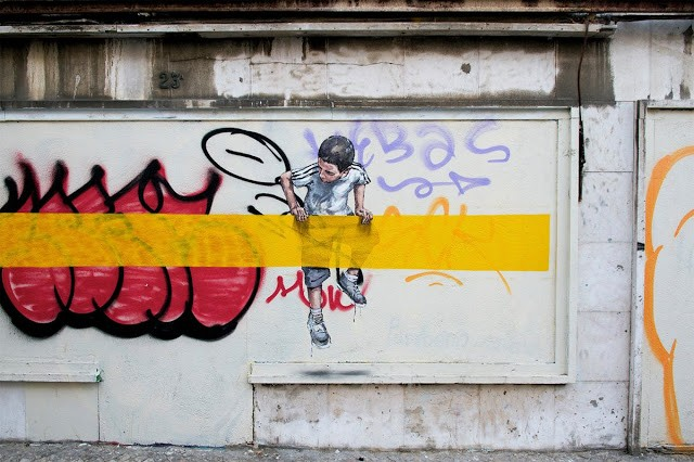 Ernest Zacharevic paints new works on the streets of Lisbon