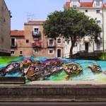 """Bordalo II builds """"Peixes d´Alcantara"""", its newest installation in Lisbon, Portugal"""