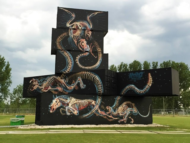 Nychos paints a giant container structure in Werchter, Belgium