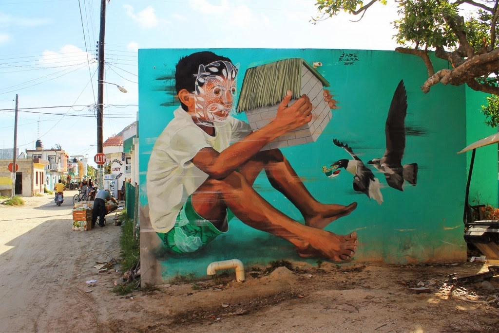 JADE paints a new mural in Holbox, Mexico