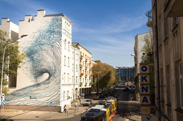 DALeast unveils a new mural in Lodz, Poland