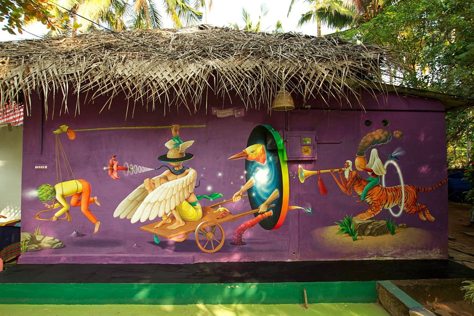 Waone from Interesni Kazki paints a new mural in Varkala, India