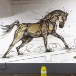 """DZIA paints """"Gold Horse"""", a new indoor piece in Antwerp, Belgium"""