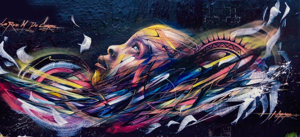 Hopare paints a new mural on the streets of Paris, France