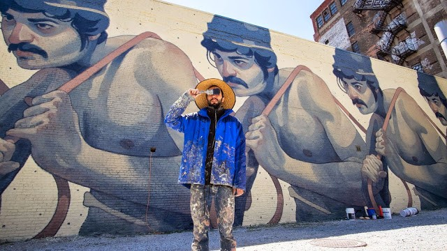 Aryz paints a large mural in Detroit, USA