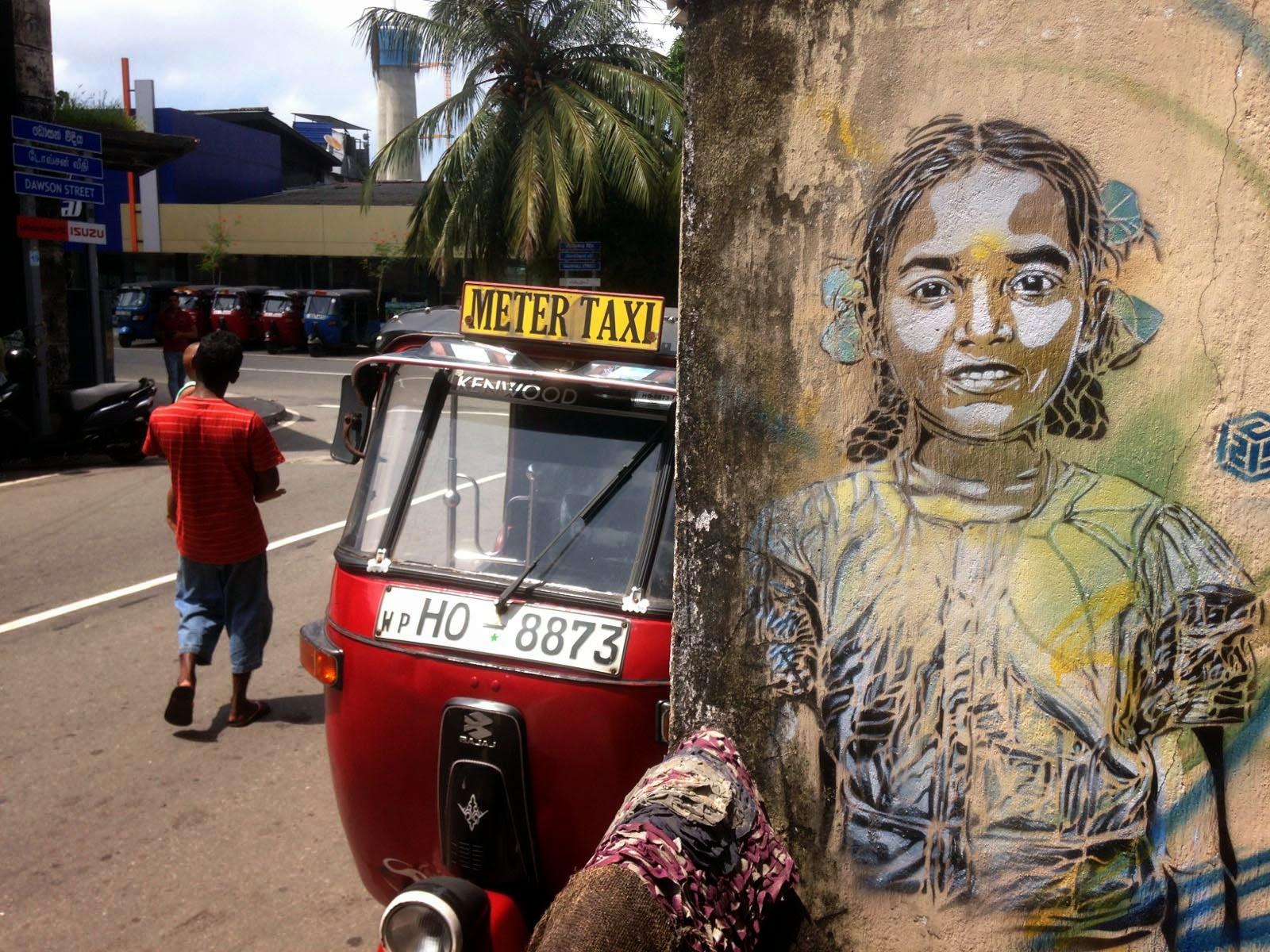 Stencil street artist C215 paints a series of pieces in Sri Lanka