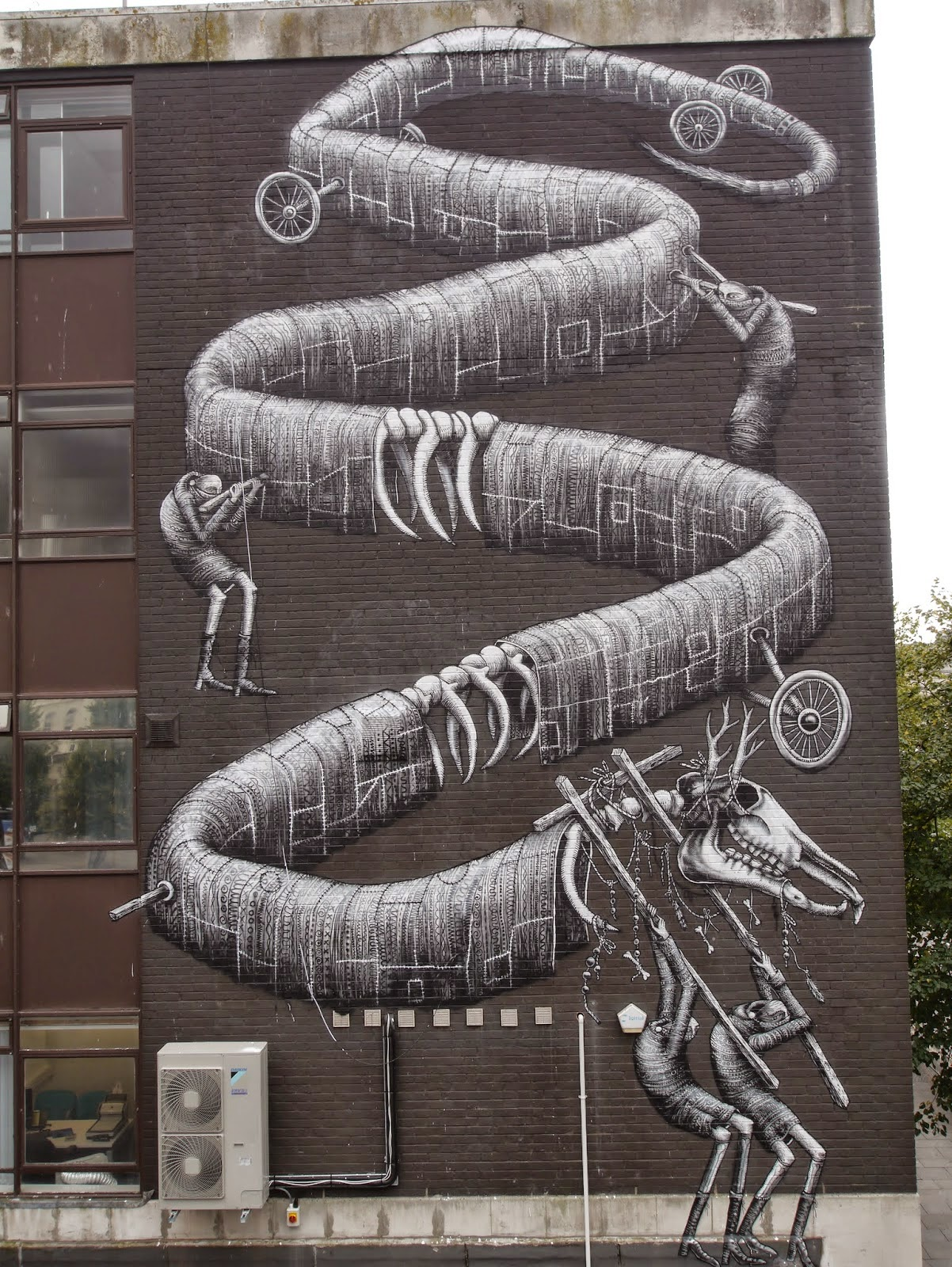 Phlegm paints a massive mural for Empty Walls Festival in Cardiff, Wales