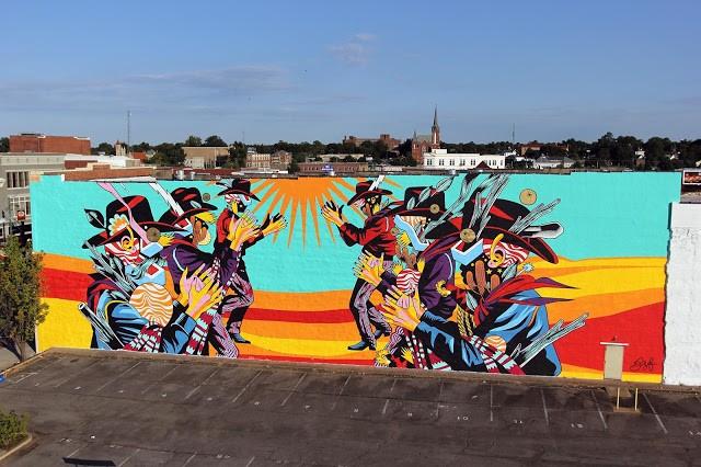 "Unexpected '15: Bicicleta Sem Freio paints ""Catira"", a massive mural in Fort Smith, Arkansas"