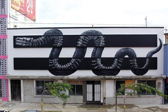 ROA paints a large mural with JustKids in San Juan, Puerto Rico