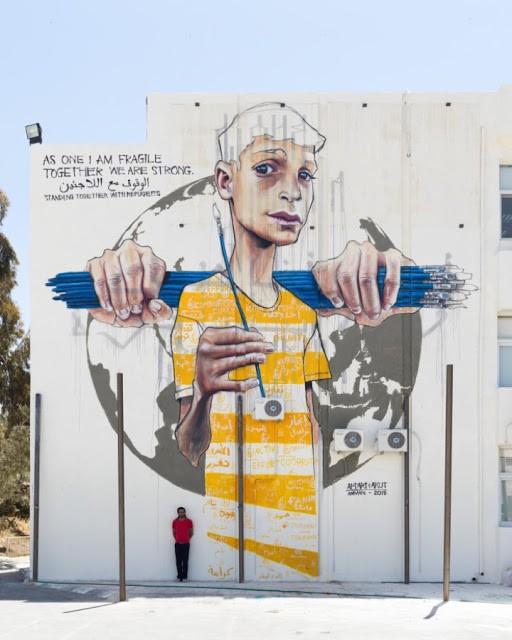 Akut from Herakut creates a large new mural in Amman, Jordan