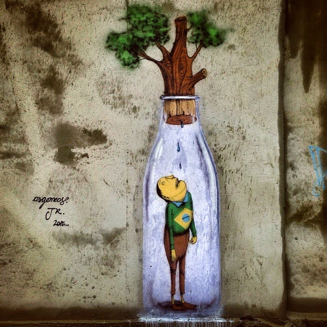 Os Gemeos and JR collaborate on a new street piece in Sao Paulo, Brazil