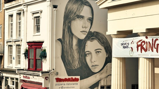 RONE paints a new mural on the streets of Brighton, UK