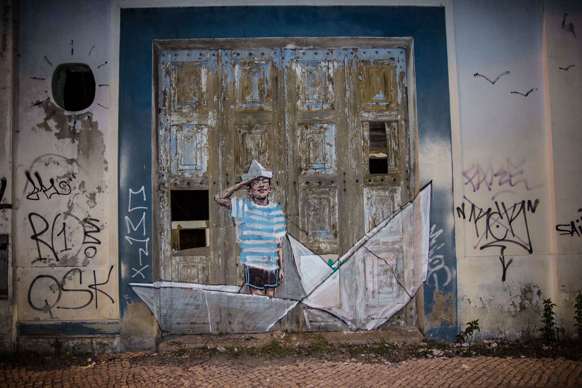 Boy in a sailboat Lisbon Credit Ernest Zacharevic
